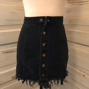 Distressed black denim skirt with gold buttons